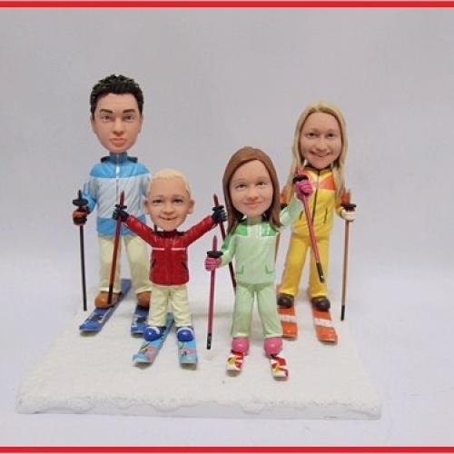 statuine personalizzate in resina famiglia sugli sci